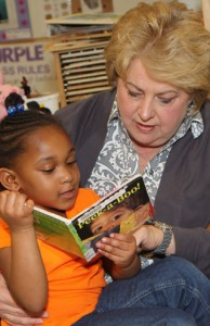 Kim reading to child